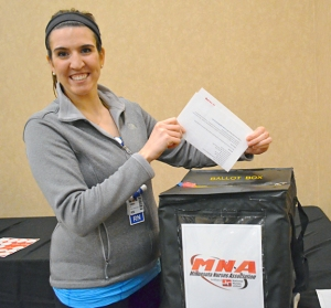 Fairview Southdale nurse Emma Sonney, who moved to Minnesota from Wisconsin last year, casts a ballot in a contract vote for the first time in her life.