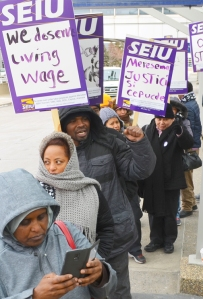 Terry Groce, third from left, walks the picket line with other MSP Airport janitors.