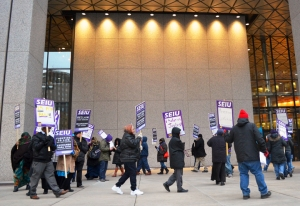 Union janitors walk a picket line outside the Securian building in downtown St. Paul.