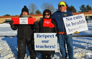 "Members of the Kreitz family show their solidarity with North Branch teachers: Joanne (L) a paraprofessional in the district; Susan, a member of the MN Nurses Association; and Steve, 49er. ""We've got to keep together or we fall,"" Susan said."