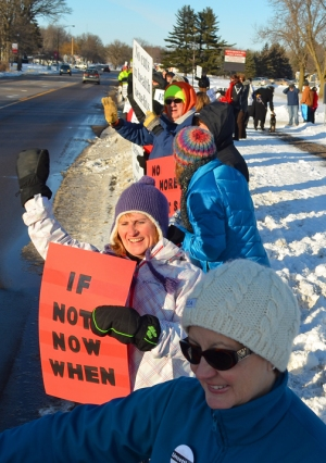 North Branch teachers and supporters line the street in front of district offices during a contract-campaign rally.
