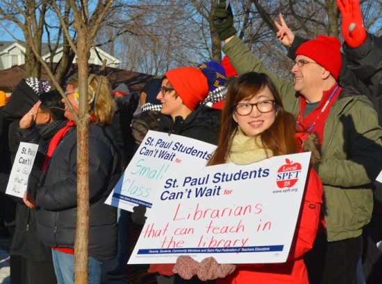 Members of the St. Paul Federation of Teachers rally with supporters before walking into the Teachers at American Indian Magnet School in St. Paul.