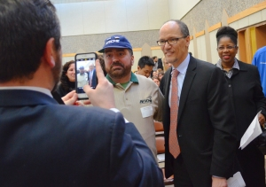 Labor Secretary Tom Perez stops for a photo with an AFSCME member at the Worker Voice Summit.
