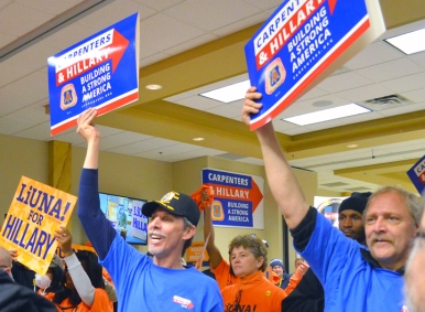 Carpenters cheer a speech by U.S. Rep. Tim Walz at the Clinton rally.