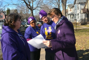SEIU President Mary Kay Henry (R) knocks doors in support of Hillary Clinton with Local 284 member Nate Mathias and SEIU Healthcare MN member Robin Pikala (L).