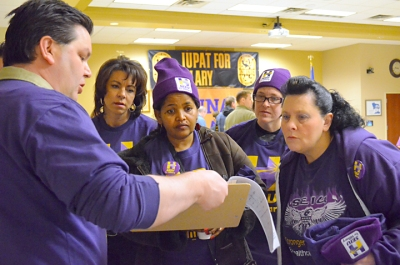 SEIU volunteers map out a door-knocking route.