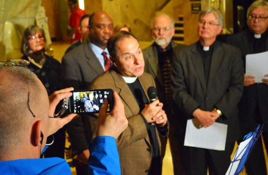 Pastor Bradley Schmeling explains his support for a citywide earned-sick-time ordinance during a press conference at St. Paul City Hall.