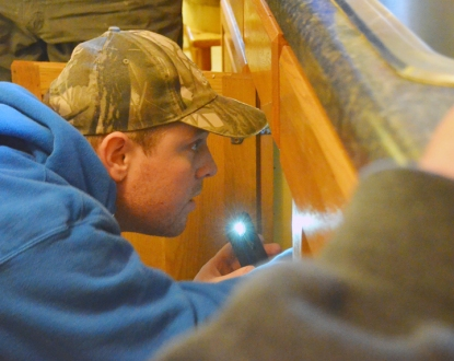 Colby Willson replaces a trap in the main-floor bathroom of a home on St. Paul's East Side.
