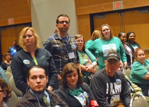 Workers who have been injured or assaulted on the job at a state mental health facility stand up during AFSCME Council 5's Day on the Hill rally.