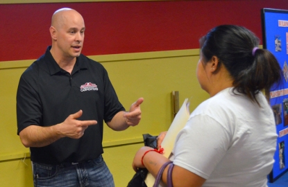 Jose Marrero of the North Central States Regional Council of Carpenters talks with jobseekers.