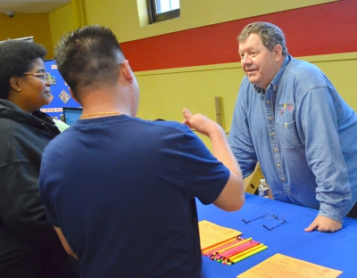 IBEW Local 110's Jim Grim (R) offers information about a career as an electrical worker.