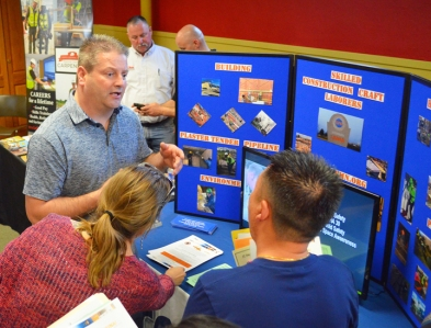 Gary Larsen, a native East-Sider and representative of the Laborers Training Center in Lino Lakes, talks with jobseekers.