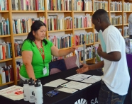 Dua Thao (L) talks about resources available to jobseekers at St. Paul's public libraries.
