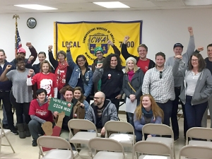 About 40 union volunteers gather in the CWA Local 7200 Hall before knocking doors in Minneapolis.