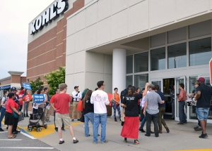 Cleaning workers and supporters demonstrated outside Kohl's, urging the retailer to follow Best Buy's lead.