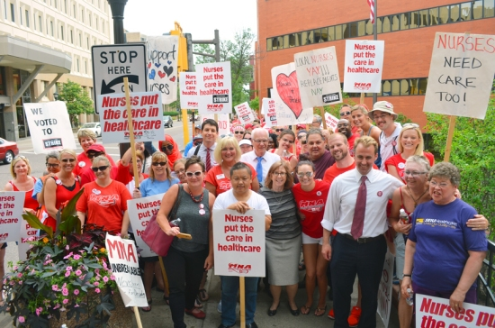 Striking nurses on the picket line outside United Hospital paused for a photo with members of the St. Paul City Council.