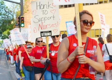 Nurses and supporters picketed outside United Hospital in St. Paul.