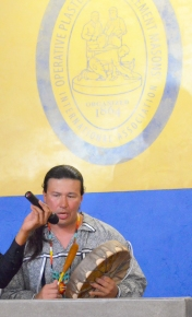 Pre-apprenticeship graduate Billy Joe Garbow of the Mille Lacs Band of Ojibwe opens the graduation ceremony at Cement Masons Local 633's hall in New Brighton with a peace song, singing and playing on a hand-crafted drum.