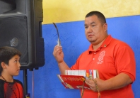 Local 633 instructor Moke Eaglefeathers tears up a little after graduates present him with an eagle feather at the end of the graduation ceremony.