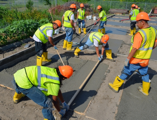 For their final project, participants in Local 633's pre-apprenticeship program finish their own flat concrete slabs with attached curbs.