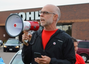 St. Paul Federation of Teachers Vice President Nick Faber speaks at a rally outside Kohl's in Roseville.