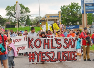 Janitors and their supporters march along County Road B2 in Roseville, near Rosedale Mall.