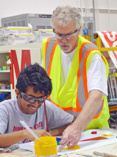 At the IUPAT District Council 82 training center in Little Canada, apprenticeship instructor Kerry Gallagher offers tips on filling in the color wheel to Randy Cuate of Minneapolis Roosevelt.