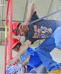 Laborers instructor Darrell Jones (R) works with Highland Park student Akshay Schneider.