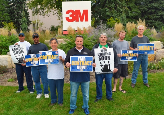 Steelworkers who staff 3M's Cottage Grove plant picket outside corporate headquarters in Maplewood.