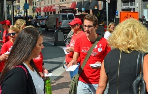 Nurses hand out fliers alerting the public that