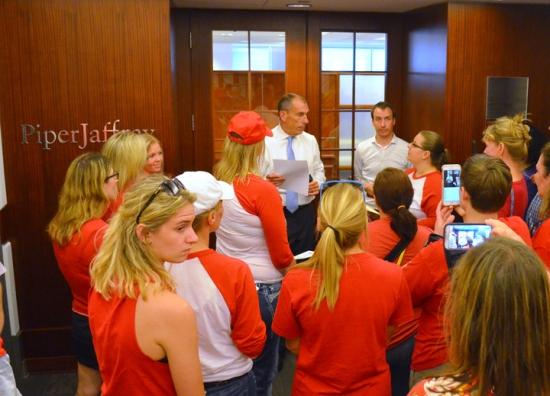 Striking nurses assemble outside Piper Jaffray's offices in downtown Minneapolis, seeking a meeting with Allina Health board member Debbra Schoneman.