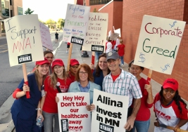 Minnesota Reps. Erin Murphy and Tim Mahoney pause for a photo with striking United RN's.