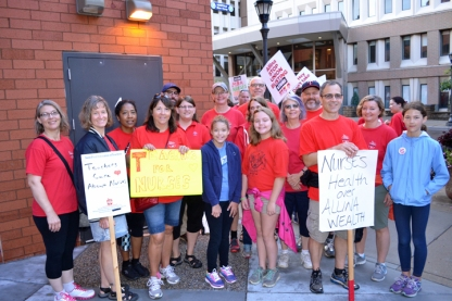 """Members of St. Paul Federation of Teachers joined the picket line at United Hospital. """"It means a lot to be here on Labor Day,"""" SPFT President Denise Rodriguez said. """"There's strength in solidarity."""""""