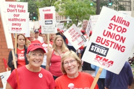 Nurses picket outside United Hospital during an open-ended strike that began at five Allina Health facilities in the Twin Cities on Labor Day.