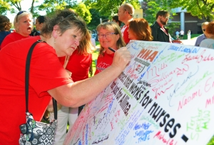 Nurses and supporters signed onto an appeal for Allina to reach an agreement that works for both sides, but security at Allina's corporate headquarters refused to allow delivery.