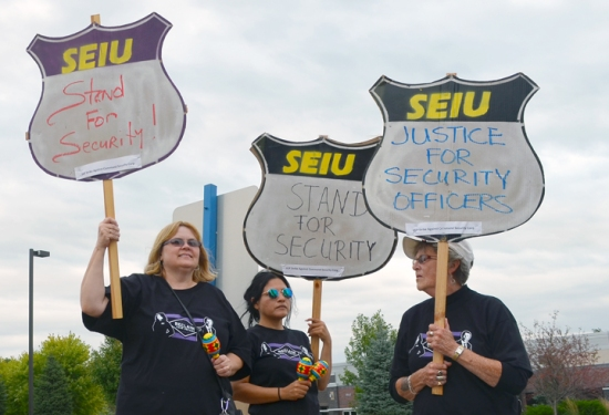 Striking Command security officers (L to R) Laurie Mattson-Collier, Isabel Alvarado and Vicky Berg walk the picket line in Eagan.