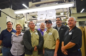 Pictured on the Hood Packaging shop floor in Arden Hills: (L to R) USW's Gerry Parzino, Beth diGrazia, USW member and apprentice Larteng Kong, apprentice Dave Frisk, USW member and apprentice Andy Ramirez, Mike Ramirez and Local 264 President John O'Neil.