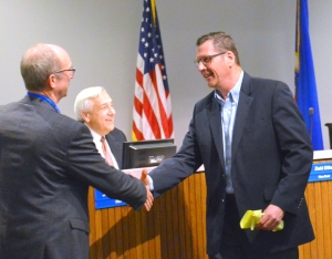 Tom McCarthy (R), president of St. Paul Plumbers Local 34, received the thanks of St. Paul school board chair Jon Schumacher during the board's Nov. 15 meeting.