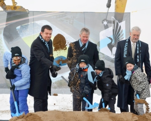 MN United's Nick Rogers (L), Mayor Chris Coleman and Dr. Bill McGuire (R) supervised a crew of youth soccer players at the new stadium's groundbreaking ceremony Monday.