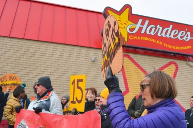 Opponents of Andy Puzder's nomination to lead the Labor department rallies last Thursday outside Hardee's in St. Paul.