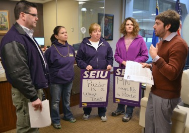 SEIU Healthcare Minnesota members (L to R) Pam Ganser, Amy Pauly and Jodi Klembrook delivered a petition opposing Andy Puzder as labor secretary to Sen. Al Franken's office in Minneapolis.