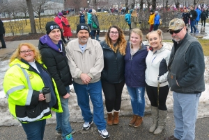 Marching against Trump's agenda were (L to R) Debra DeBruzzi, Operating Engineers 49; Casey Hudek and Karlan Bean, Teamsters 120; Megan Bean, Christina Nelson and Kiya Caturia of Gustavus Adolphus College; and Rod Olson of Local 120.