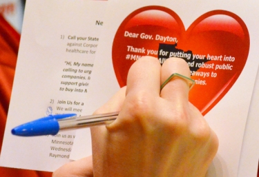Rally participants signed Valentine's Day cards to Gov. Dayton urging him to stand against legislation that would bail out insurance companies.