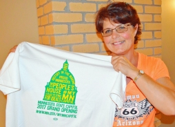 Renee Gisch showed off a shirt distributed to tradespeople who logged hours on the renovation.