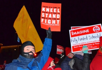 As the NFL staged its Open Night Party in St. Paul Monday, protesters shut down several streets downtown, calling on Super Bowl sponsors to support local schools and racial equity.