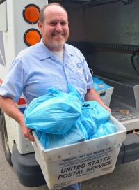 South St. Paul carrier David Schimerowski has never missed a Stamp Out Hunger Saturday in 21 years as a Letter Carrier.