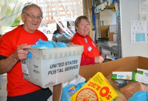 Machinists Local 1833 retirees Tom Hoppenstedt and Mary Sansom unload food at Neighbors Inc. in South St. Paul, which brought in 24,458 pounds on Stamp Out Hunger day 2018.