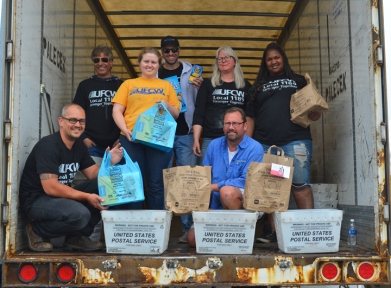 UFCW Local 1189 volunteers in Oakdale include (L to R) James Westin, Manzoor Wangnoo, Diana Tastad-Damer, Abraham Wangnoo, President Jennifer Christensen, Dennis McMahon and Zendaya Adkins.