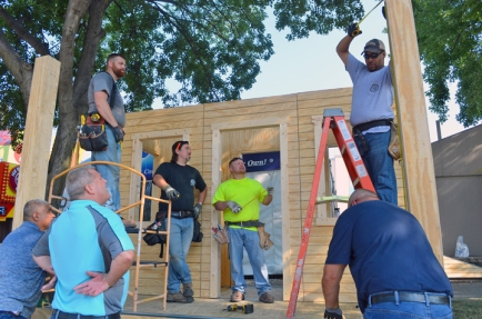 St. Paul Building Trades volunteers on hand to help frame Sen. Amy Klobuchar's new state fair booth included, L to R, (back) Ryan Ponthan, Rob Busch, Mick Christy and Aaron Hill of the North Central States Regional Council of Carpenters, and (front) Joe Navejas, Laborers Local 563; Tim House, Plasterers Local 265; Brian Gullickson, Cement Masons 633.