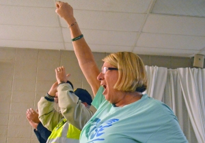 AFSCME volunteer Sheila Pokorny lets out a cheer.